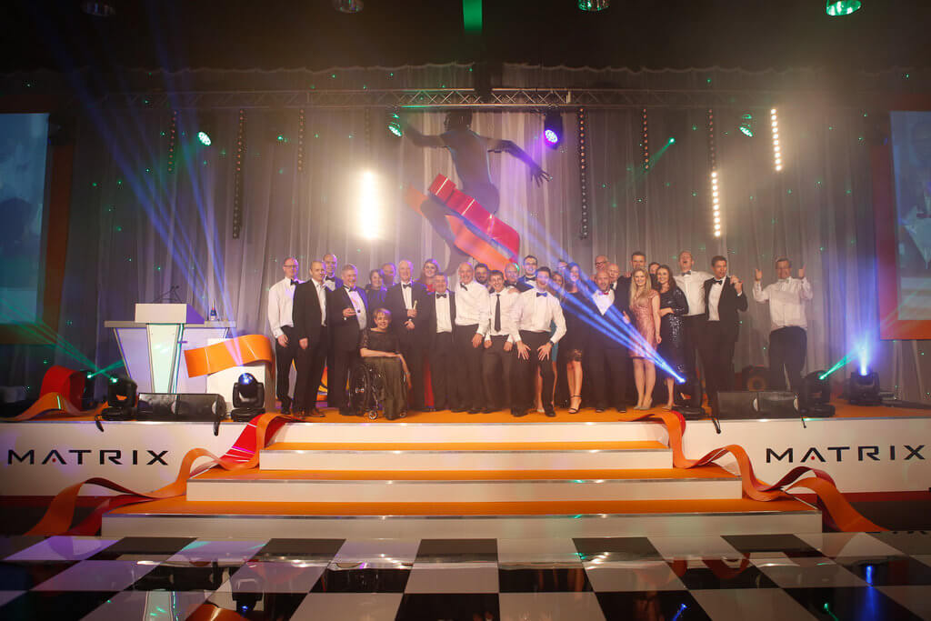 Everyone Active on stage celebrating winning Leisure Operator of the Tear at UKActive Flame awards in June 2016